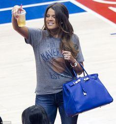 Khloe Kardashian courtside wearing the Junk Food Dallas Mavericks t shirt!  Buy it here  http://www.junkfoodclothing.com/webapp/wcs/stores/servlet/Product1_10052_10051_-1_22420_20058_20137