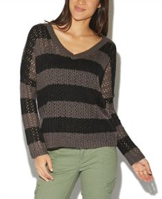 """With its open work and lightweight body this pullover sweater is perfect for layering! It features a tonal striped pointelle knit body, ribbed trim, v-neckline, and a relaxed fit. Model is 5'10"""" and wears a size small      93% Acrylic / 7% Other Fibers     Machine Wash     Imported"""