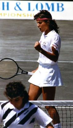 Gabriela Sabatini of Argentina clenches her fist after winning a key point as Arantxa  Sánchez Vicario of Spain walks away from the net during their semifinal match at the 1991 Amelia Island Championships. Sabatini defeated Arantxa by a final score of 6-2, 2-6, 6-4. It was sweet revenge for Sabatini, as she had lost to Arantxa the previous year in the semifinals at Amelia Island.