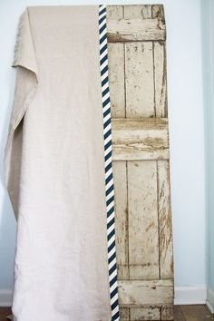 DIY curtains {for James' big boy room?}: linen {or canvas drop cloth} + navy chevron fabric strips folded in half for the striped edge