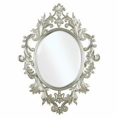 """Ornate wall mirror with laurel leaf and scroll detail in a hand-applied silver finish.   Product: Wall mirrorConstruction Material: Polyurethane and mirrored glassColor: Silver leafFeatures: Can be mounted vertically or horizontallyDimensions: 38"""" H x 28"""" W"""