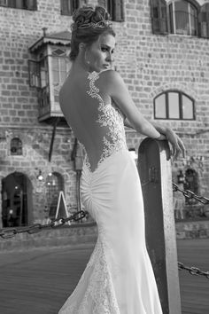 La Dolce Vita - Antonia  Back view - tight double-faced stretched silk satin with a sheer back. The gown has a dramatic train with multiple embroidered trims.