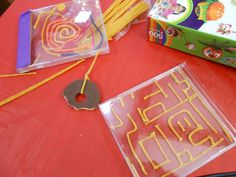 CD case mazes using Bend-a-roos (wax-covered string), empty CD cases, duct tape, a BB pellet, and scissors. Cut the Bend-a-roos into various lengths & press them down into the CD case. Test the maze with the BB pellet. A big hit!