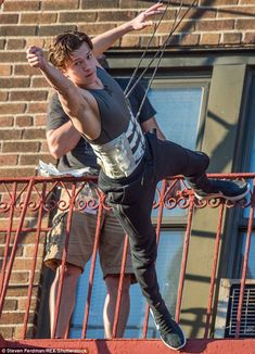 Giving it a go: The actor was earlier spotted practising the move while clad in his workout wear and strapped into a harness