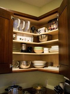 Easy Reach Upper Cabinet:  I can see everything I need when I open the doors.  It's so much better than diagonal one and you will be in love with it. Your countertop will also look bigger.