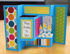 Jenny Rowan created this fun birthday pop-up card for us and you can make this too!   Supply list: Blue Cardstock Designer Patterned ...