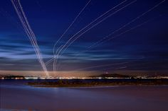 Long exposure photos of planes taking off and landing at our hometown airport, SFO.