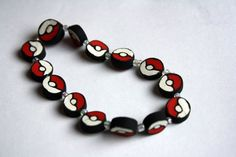 Hey, I found this really awesome Etsy listing at https://www.etsy.com/listing/78130788/beaded-pokeball-bracelet