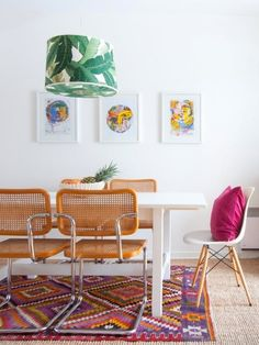This home is a vibrant mix of second-hand finds, DIY projects and things brought back from travels. It is filled with color, warmth and creativity. The dining room has fun pops of pink and green.