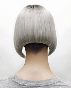 What a classic wit a twist, love the undercut... love the neckline. Perfection