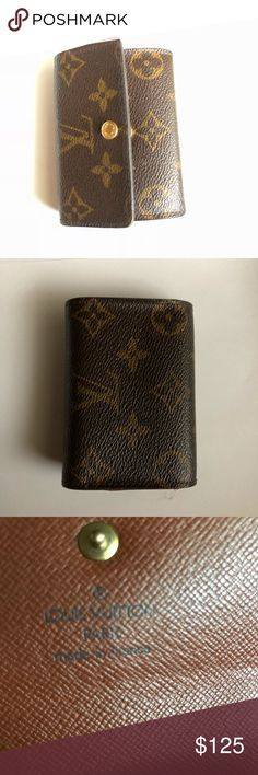 """Louis Vuitton monogrammed card holder authentic Louis Vuitton monogrammed card holder authentic Date code- MI0090 4""""x 3"""" Condition exterior  Monogrammed canvas is in good condition. Edges and siding have light wear snap is loose . See photos  Condition interior Peeling is present in interior compartments see photos no stickiness Louis Vuitton Accessories Key & Card Holders"""