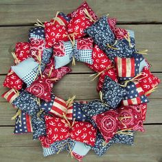 "Americana Country Wreath:  ""Pillows of fabric attached to a 12 wire form with satin ribbon and or raffia""...  LOVE!!"