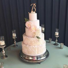 Minet Rushing:  Wedding cake.    5-tiers in pale pink.  Roses and fantasy flowers.  ♡♡♡♡♡