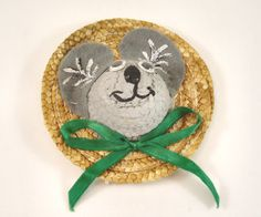 Make a mouse (or another animal) out of a small straw hat