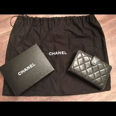 Authentic Chanel Wallet Authentic Chanel Black Lambskin wallet. Burgundy inside. Good condition with minor wear on the corners. Comes with box and dust bag. CHANEL Bags Wallets
