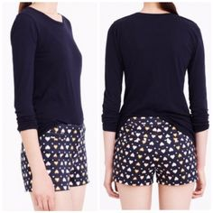 j crew heart dot shorts Adorable shorts from J Crew Factory. Navy blue with pink, gold and white heart and dot pattern. Front slant pockets, back slit pockets. 3-inch length. Button tab closure. Size 6. Worn once and in like new condition! More photos coming soon. J. Crew Shorts