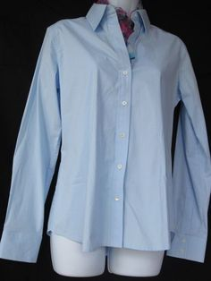 Banana Rebublic $24.99    Medium, light blue, button down classically tailored shirt.      ***Tags are not on this item, but package of buttons are, so we know its new.        Bust measures 37 inches.  Sleeve length is 25 inches.