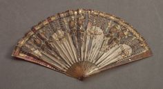 Folding fan with tortoiseshell sticks, a satin and net leaf decorated with gold sequins and chenille. French c1800. FAMSF