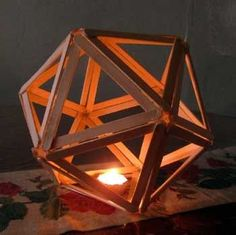 In geometry, an icosahedron is a regular polyhedron with 20 identical equilateral triangular faces, 30 edges and 12 vertices. It is one of the five Platonic solids. ^^ CLIK PIN FOR MORE INFO ^^ Popsicle Stick Crafts Craft Stick Projects, Craft Stick Crafts, Wood Crafts, Fun Crafts, Diy And Crafts, Arts And Crafts, Craft Sticks, Wood Projects, Craft Ideas