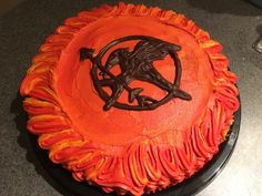 Mockingjay Chocolate Cake with Peanut Butter Frosting for my awesome avid reader who loves the girl on fire and the boy with the bread. #hungergames #mockingjay #girlonfire #catchingfire #hungergamescake #mockingjaycake