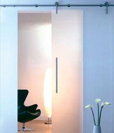 Rail Door Track - this looks pretty easy. Sliding Room Doors, Sliding Door Track, Partition Door, Visual Display, Folding Doors, Hidden Storage, Rental Property, Candle Sconces, How To Look Pretty