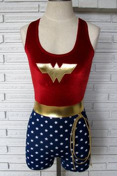 The Wonder Woman inspired costume is red stretch velvet or supplex with built in shelf bra. Elastic around the neck and arms keeps everything in place. The belt and applique are metallic gold spandex. The shorts bottoms are spandex with white stars. Shorts have a 3 inseam, if you need longer please make a note at checkout. This listing is for singlet only, lasso not included! Currently available in stretch velvet or supplex top with royal blue bottoms. This is a made to order item…
