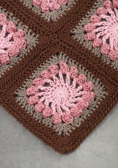 podkins: This lovely granny square throw is called the Santa Rosa Throw (designed by Kim Biddix). The free pattern can be sourced here from Naturally Caron. Filing this away to make.
