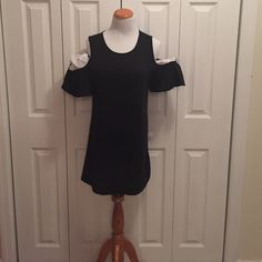 Black short high neck dress with cut out shoulders New with tag. Never worn black shirt casual dress with open shoulders. It's a large but runs small. More like a medium. Dresses Mini