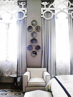 Venice's Gritti Palace Hotel. The vintage Fornasetti plates depict Italian architectural domes and glimpsed above the bed is a framed Hermès scarf.
