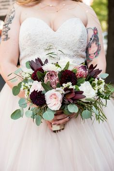 Gorgeous medium sized fall jewel toned bridal bouquet with dark red proteas and dahlias for a vintage modern wedding on Virginia wedding blog #weddingflowers #bouquet #bridal #bride #bouquets #weddingbouquet #fallwedding #vintagewedding