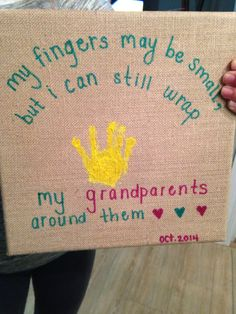 my fingers may be small, but I can still wrap my grandparents around them - gift for grandma.   burlap canvas from hobby lobby, non-toxic paint for handprint, and colored medium-tip permanent markers.