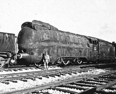 Photo 3 of the German DR #19.1001 armored steam locomotive sitting in a U.S. rail yard having been shipped after the war. It was the only one built and supplied service before and during hostilities before being captured.