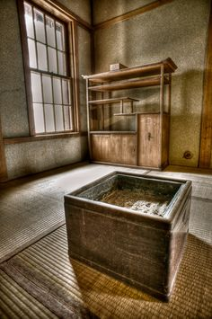 Japanese room at Nishimura House with earthen plaster walls, a highly refined craft in Japan.