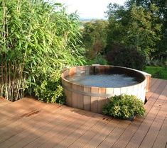 Ofuro Japanese soaking tub = something my father might need after living on the farm for a while? Northern Lights Cedar Tubs hot tub picture gallery gives unique ideas from installing to use of your own cedar hot tub at home. Japanese Bathtub, Japanese Soaking Tubs, Outdoor Tub, Outdoor Dining, Dining Area, Stock Tank Pool, Tub Shower Combo, Small Pools, Northern Lights