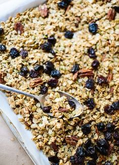 Healthy granola recipe, using maple syrup (or honey), coconut oil, old-fashioned oats and nuts and dried fruit of your choosing! This granola is the BEST! cookieandkate.com