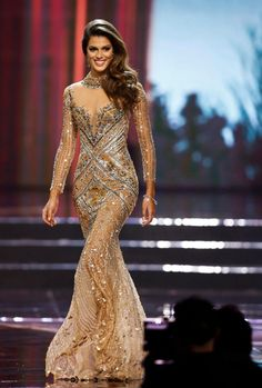 Miss France Iris Mittenaere wowed the crowds in a golden ballgown
