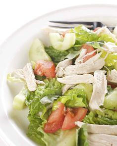 Poached Chicken Salad with Chopped Vegetables | Martha Stewart Living - Toss moist poached chicken-breast slices with chopped tomato, cucumber, fresh basil, and shredded romaine lettuce. Dress this chicken salad with a tangy lemon vinaigrette and serve as a light dinner or lunch.