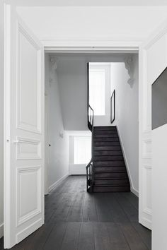 An amazing all white home in the Netherlands black stairs