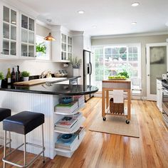 white backsplash, conservative paint color... layout would work in our kitchen. Not so sure about the beadboard or the black countertops.