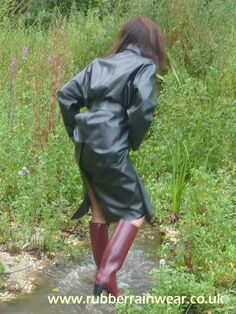 Dressed for paddling in her black rubber mac and brown boots Hunter Wellies, Rubber Raincoats, Weather Wear, Raincoats For Women, Rain Wear, Black Rubber, Brown Boots, Macs, Rain Jacket