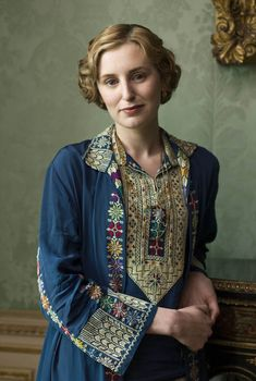 "Downton Abbey Fashion: Lady Edith Crawley | Costume designer Anna Mary Scott Robbins: ""With Lady Edith, there's always something that's interesting. Everything is quite tactile and the detail gets more, the closer you look. This is a very, very delicately cross-stitched three-piece that was pantaloons—it was a very fashion forward 1920s design... We matched the creamy buttermilk and had a skirt pleated up and paired with it."""