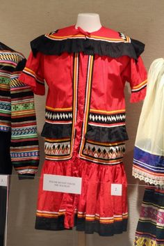 """""""Medicine Man's"""" Coat, Jimmie O. Osceola, Panther Clan, Miccosukee, Cotton. In the 1890s all men wore this style coat. By the 1930s onlya few older men wore this garment, which came to be called a """"medicine man's"""" coat. The medicine colors are red, yellow, black and white."""