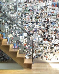 The wall beside the stairs has been clad with sheets of blackened steel on which photos can be placed with magnets.