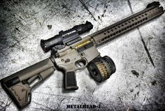 Salient Arms International AR15  Please note the titanium nitride (TiN) coated bolt and full rifle length gas system on a 16 inch total LVOA rail (14.5 barrel + pinned/welded comp). All of which makes for an extremely soft shooting weapon with reduced muzzle flash