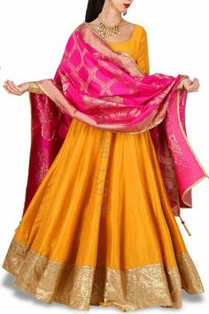Marigold Anarkali Banarasi Dupatta Price: INR 6490 Marigold Anarkali Banarasi Dupatta For the woman who prefers elegant minimalism, this anarkali is tailored with a hint of glam sequins and a dash of heritage handloom… Party Wear Indian Dresses, Indian Gowns Dresses, Indian Fashion Dresses, Indian Designer Outfits, Indian Outfits, Designer Dresses, Kurti Designs Party Wear, Kurta Designs, Blouse Designs