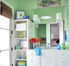 add tall storage to side of vanity (basement bathroom)