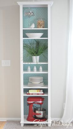 sugartotdesigns: White Bookshelf Makeover with removable wrapping on the backing board. DOING this