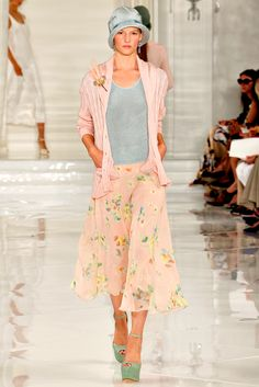 3/1/15 This light pink and blue ensemble by Ralph Lauren is reminiscent of the 1920s. The pleats, cloche hat, and tubular silhouette are all indicators of that time. The length and straight silhouette are also similar to that of the flapper dress.