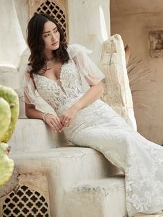 Sottero and Midgley - EASTON, Chic and exquisite (yet perfectly un-stuffy), this unique low back fit-and-flare wedding dress appeases your boho heart while elevating your effortless style.