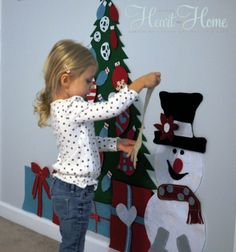 Totally doing this - felt sticks to felt. No sewing at all. Just cut, stick it on the wall (or foam board then lean against the wall), and cut ornaments, presents, etc. for kids to decorate (and undecorate!).